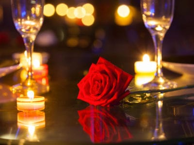 a romantic dinner setting with a rose